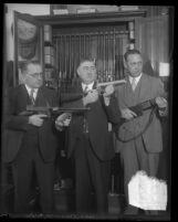 Los Angeles police detective E. Ray Cato and two other men posing with guns, circa 1925