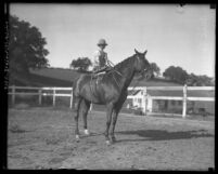 Josephine Callaghan mounted on one of her horses, circa 1929