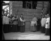 Bishop Cantwell and other clergy members at ceremony in front of an unfinished St. Vincent's Hospital.