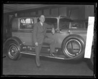 Walter P. Chrysler posing next to a Chrysler Six, circa 1924