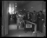 Woman selling ice cream to the crowd in courthouse hallway at David H. Clark's murder trial in Los Angeles, Calif.,1931