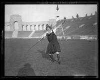 Lillian Copeland posing at Los Angeles Coliseum with javelin, circa 1928