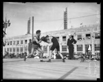 Boxer Leach Cross and his partner sparing in outdoor ring in Los Angeles, Calif., circa 1921