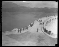 People on Mulholland Dam the day it was opened in Los Angeles, Calif., 1925
