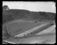 Workmen pouring concrete at Puddingstone Dam site