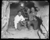 Men in canyon tunnels preparing to set explosives for blasting excavation during construction of San Gabriel Dam, Calif., 1929