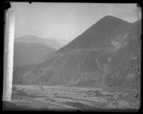 San Gabriel Canyon wall just before explosion during blasting excavation for construction of San Gabriel Dam, Calif., 1929
