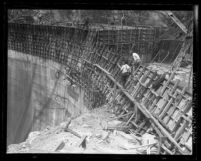 Workers walking on the face of Santa Anita Dam during construction, Calif., circa 1926