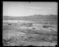 Rescue teams searching the flood plain after St. Francis Dam disaster in Santa Clara River Valley (Calif.), 1928