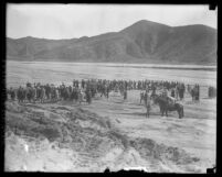Funeral procession crossing the flood plain after St. Francis Dam disaster in Santa Clara River Valley (Calif.), 1928