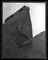 View from below, looking up at remains of St. Francis Dam after its disastrous collapse, Francisquito Canyon (Calif.), 1928
