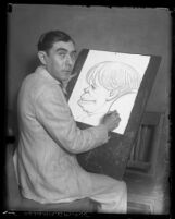 Mexican artist Enrique de la Pena sketching a caricature, 1930