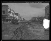 Main Street in Burbank, Calif.  covered in debris from flooding caused by rainstorm, 1928