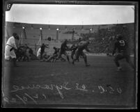 Football mid-field action U.S.C. vs. Syracuse at the L.A. Coliseum in 1924