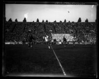 Football mid-play action receiving, U.S.C. vs. Notre Dame at the L.A. Coliseum circa 1928