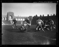 Football mid-play action, blocking U.S.C. vs. Notre Dame at the Coliseum, Los Angeles, circa 1928