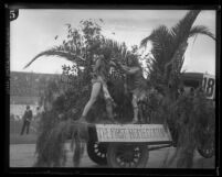 USC 1925 homecoming float called 'The First Homecoming' depicting two stone age warriors in combat