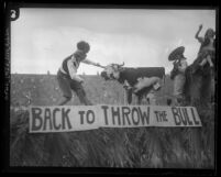 "USC 1925 Homecoming float titled 'Back to Throw the Bull,"" depicting a Trojan taking on a Bull"