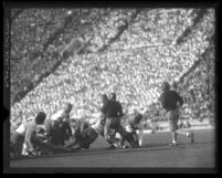 Football U.S.C. vs. Washington player being tackled just beyond the line of scrimmage in 1927