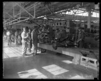 Workers on the assembly line at Ford Motor plant in Long Beach