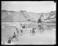Flooded gravel pits and workers of Blue Diamond Cement Company