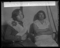 Suspected murder accomplice Dolores Huichata seated next to Marion Vasquez in Los Angeles, Calif. circa 1929