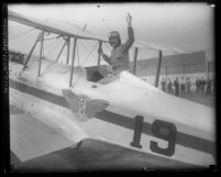 Aviatrix Laura Ingalls waiving from cockpit of plane in Los Angeles, Calif., circa 1930