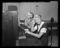 Operators Grace Miller and Theresa Vincent in 1959 manning the switchboard at Los Angeles' Air Pollution Control District office