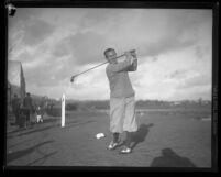 Golfer Al Espinosa posing, post-swing, circa 1920