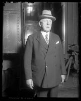 3/4 length portrait of U.S. Steel president James A. Farrell in front of train, circa 1920
