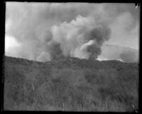 Plumes of smoke from wildfire rising from Decker Canyon, Calif. circa 1920