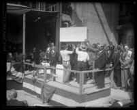 Los Angeles City Hall's cornerstone being lowered down to its place during ceremonies in 1927