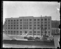 Exterior of city jail at Lincoln Heights with street in front, circa 1920