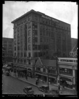 Los Angeles city street with Majestic Theater building, circa 1920