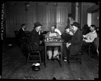 Men playing checkers and reading at Los Angeles Men's club, circa 1920