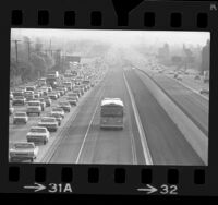 Rapid Transit District bus traveling in El Monte-Los Angeles bus lane, passing rush hour traffic on San Bernardino Freeway, 1973