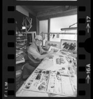 Artist Noel J. Quinn in his studio, working on horse racing paintings in Los Angeles, Calif., 1973