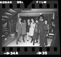 Designer Jean Louis posing with United Air Lines flight attendants wearing uniforms he designed, Los Angeles, Calif., 1973