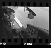 Radio station KGIL's traffic reporter, Francis Gary Powers at controls of plane in Los Angeles, Calif., 1973