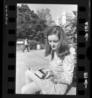 UCLA engineering student, Dianne Shows using a pocket calculator in Los Angeles, Calif., 1973