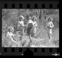 Five Las Candalistas members standing on trail, holding artifacts used for Walk on the Wild Side nature tours of Palos Verdes Peninsula, Calif., 1973