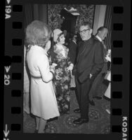 Actress Ann Blyth talking with Cardinal Timothy Manning at Ladies of Charity luncheon in Los Angeles, Calif., 1973