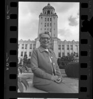 Mayor Phyllis Seaton, seated in front of city hall, Beverly Hills, 1973