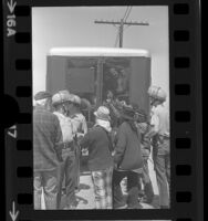Striking grape workers held in van as sheriffs guard other arrestees at H&M Tenneco farm in Riverside County, Calif., 1973