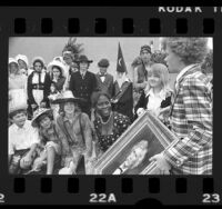 Actors Jodie Foster and Johnny Whitaker presenting painting to Mark Twain Junior High school students in Venice, Calif., 1973