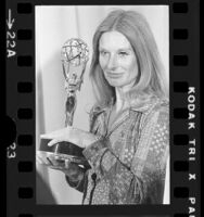 Cloris Leachman holding her Emmy at the 1973 Emmy Awards
