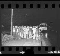 Jefferson Junior High School students waiting for bus in the dark [due to Energy Crisis] in San Gabriel, Calif., 1974