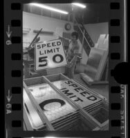 "Safeway Sign Company employee Gil Plazola stacking ""Speed Limit 50"" signs in Gardena, Calif., 1973"