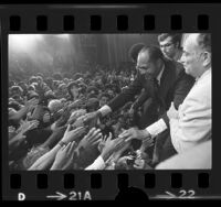 Mayor-elect Tom Bradley shaking hands with supporters at mayoral victory celebration in Los Angeles, Calif., 1973