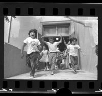Second graders running out of door on last day of school at Dayton Heights Elementary School in Los Angeles, Calif., 1973